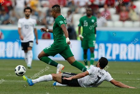 Saudi Arabia's Salem Aldawsari, left, is challenged by Egypt's Ahmed Fathi during the group A match between Saudi Arabia and Egypt at the 2018 soccer World Cup at the Volgograd Arena in Volgograd, Russia