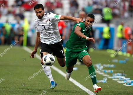 Egypt's Ahmed Fathi, left, and Saudi Arabia's Salem Aldawsari challenge for the ball during the group A match between Saudi Arabia and Egypt at the 2018 soccer World Cup at the Volgograd Arena in Volgograd, Russia
