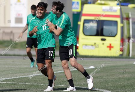Australia's Robbie Kruse, right, joke with teammate Daniel Arzani during the the official training on the eve of the group C match between Peru and Australia at the 2018 soccer World Cup, in Sochi, Russia
