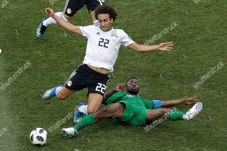 Egypt's Amr Warda, left, and Saudi Arabia's Osama Hawsawi battle for the ball during their group A match at the 2018 soccer World Cup at the Volgograd Arena in Volgograd, Russia