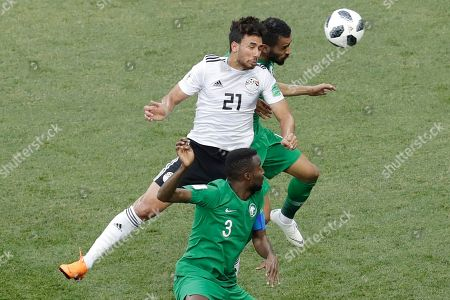 Egypt's Trezeguet (6) goes for a header challenged by Saudi Arabia's Osama Hawsawi (3) and Mohammed Alburayk during the group A match between Saudi Arabia and Egypt at the 2018 soccer World Cup at the Volgograd Arena in Volgograd, Russia