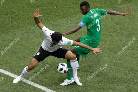 Saudi Arabia's Osama Hawsawi, right, challenges for the ball Egypt's Marwan Mohsen during the group A match between Saudi Arabia and Egypt at the 2018 soccer World Cup at the Volgograd Arena in Volgograd, Russia