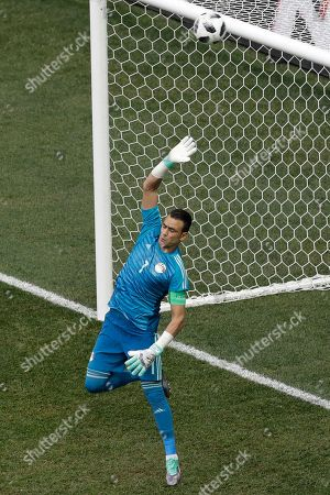 Egypt goalkeeper Essam El Hadary saves a shot during the group A match between Saudi Arabia and Egypt at the 2018 soccer World Cup at the Volgograd Arena in Volgograd, Russia