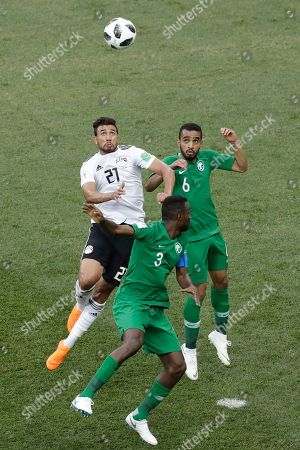 Egypt's Trezeguet, right, goes for a header with Mohammed Alburayk (6) and Osama Hawsawi, both of Saudi Arabia, during their group A match at the 2018 soccer World Cup at the Volgograd Arena in Volgograd, Russia