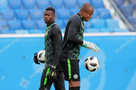 Nigeria goalkeepers Ikechukwu Ezenwa, right, and Francis Uzoho attend official training in St.Petersburg, on the eve of the group D match between Nigeria and Argentina at the 2018 soccer World Cup in the Saint Petersburg Arena