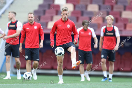 Denmark's Viktor Fischer dribbles the ball during Denmark's official training at the eve of the group C match between France and Denmark at the 2018 soccer World Cup in the Luzhniki Stadium in Moscow, Russia