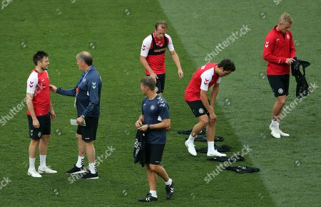 Stock Picture of Denmark national soccer team head coach Age Hareide (2L) talks to William Kvist during their training session at Luzhniki Stadium in Moscow, Russia, 25 June 2018. Denmark will face France in the FIFA World Cup 2018 group C, preliminary round soccer match on 26 June 2018.