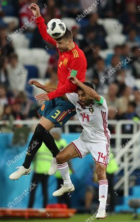 Gerard Pique of Spain and Mbark Boussoufa of Morocco