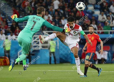 Goalkeeper David de Gea of Spain and Mbark Boussoufa of Morocco