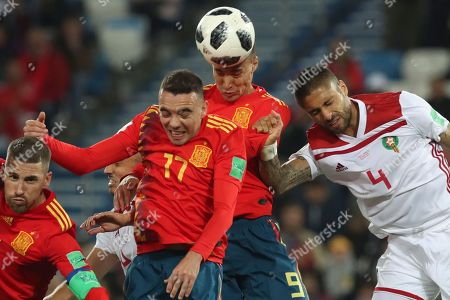 Morocco's Manuel Da Costa, right, jumps for the ball with Spain's Rodrigo, second right, and Spain's Iago Aspas, center, during the group B match between Spain and Morocco at the 2018 soccer World Cup at the Kaliningrad Stadium in Kaliningrad, Russia