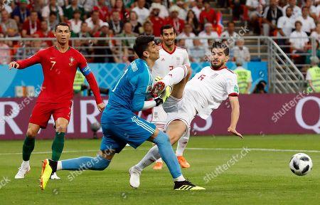 Saeid Ezatolahi of Iran, Goalkeeper Ali Beiranvand of Iran and Cristiano Ronaldo of Portugal
