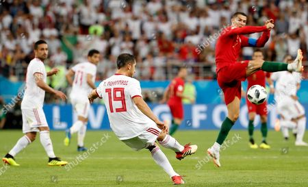 Majid Hosseini (L) of Iran and Cristiano Ronaldo of Portugal in action during the FIFA World Cup 2018 group B preliminary round soccer match between Iran and Portugal in Saransk, Russia, 25 June 2018. (RESTRICTIONS APPLY: Editorial Use Only, not used in association with any commercial entity - Images must not be used in any form of alert service or push service of any kind including via mobile alert services, downloads to mobile devices or MMS messaging - Images must appear as still images and must not emulate match action video footage - No alteration is made to, and no text or image is superimposed over, any published image which: (a) intentionally obscures or removes a sponsor identification image; or (b) adds or overlays the commercial identification of any third party which is not officially associated with the FIFA World Cup)