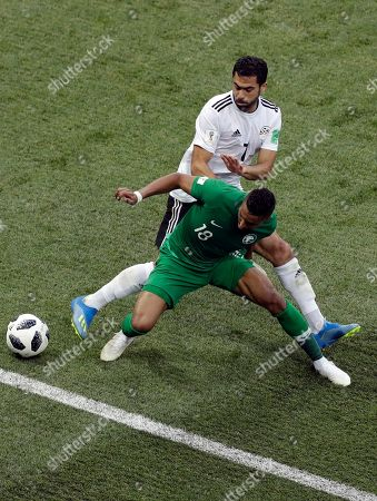 Saudi Arabia's Salem Aldawsari, front, is challenged by Egypt's Ahmed Fathi during the group A match between Saudi Arabia and Egypt at the 2018 soccer World Cup at the Volgograd Arena in Volgograd, Russia