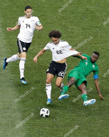 Egypt's Amr Warda middle, is challenged by Saudi Arabia's Osama Hawsawi, right, during the group A match between Saudi Arabia and Egypt at the 2018 soccer World Cup at the Volgograd Arena in Volgograd, Russia