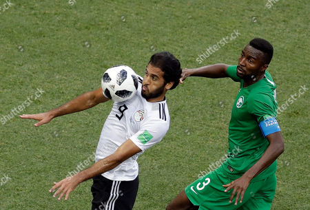 Saudi Arabia's Osama Hawsawi, right, challenges Egypt's Marwan Mohsen during the group A match between Saudi Arabia and Egypt at the 2018 soccer World Cup at the Volgograd Arena in Volgograd, Russia
