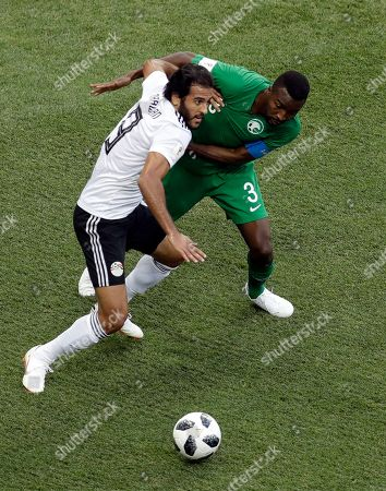 Egypt's Marwan Mohsen, left, is challenged by Saudi Arabia's Osama Hawsawi during the group A match between Saudi Arabia and Egypt at the 2018 soccer World Cup at the Volgograd Arena in Volgograd, Russia