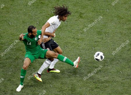 Saudi Arabia's Abdullah Otayf, left, and Egypt's Mohamed Elneny vie for the ball during the group A match between Saudi Arabia and Egypt at the 2018 soccer World Cup at the Volgograd Arena in Volgograd, Russia