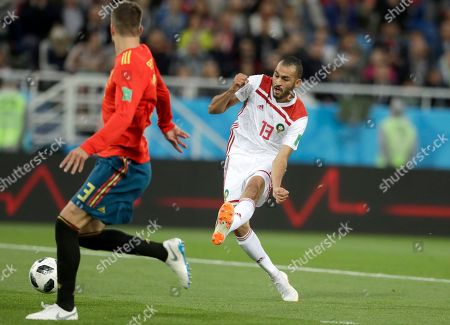 Morocco's Khalid Boutaib shoots to score his side's first goal during the group B match between Spain and Morocco at the 2018 soccer World Cup at the Kaliningrad Stadium in Kaliningrad, Russia