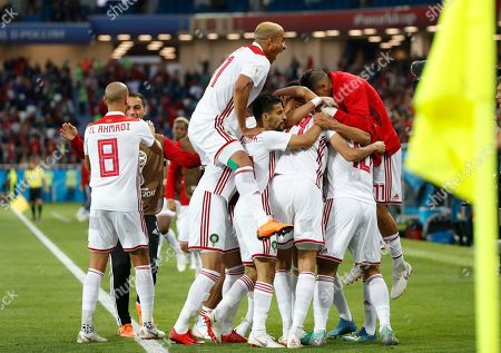Morocco players celebrate their side's first goal, scored by Khalid Boutaib during the group B match between Spain and Morocco at the 2018 soccer World Cup at the Kaliningrad Stadium in Kaliningrad, Russia