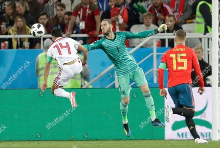 Spain goalkeeper David De Gea jumps for the ball together with Morocco's Mbark Boussoufa during the group B match between Spain and Morocco at the 2018 soccer World Cup at the Kaliningrad Stadium in Kaliningrad, Russia