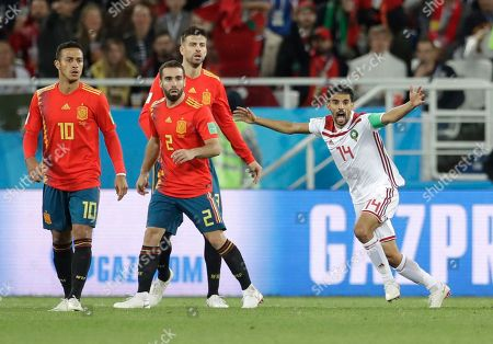 Morocco's Mbark Boussoufa gestures after a contact with Spain goalkeeper David De Gea during the group B match between Spain and Morocco at the 2018 soccer World Cup at the Kaliningrad Stadium in Kaliningrad, Russia