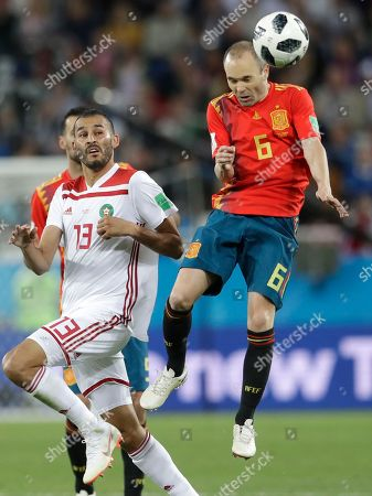 Spain's Andres Iniesta, right, heads a ball next to Morocco's Khalid Boutaib, during the group B match between Spain and Morocco at the 2018 soccer World Cup at the Kaliningrad Stadium in Kaliningrad, Russia