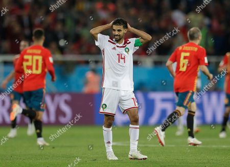 Morocco's Mbark Boussoufa reacts after Spain scored a late equalizer during the group B match between Spain and Morocco at the 2018 soccer World Cup at the Kaliningrad Stadium in Kaliningrad, Russia
