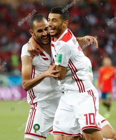 Morocco's Khalid Boutaib, left, celebrates scoring his side's first goal with Morocco's Younes Belhanda during the group B match between Spain and Morocco at the 2018 soccer World Cup at the Kaliningrad Stadium in Kaliningrad, Russia