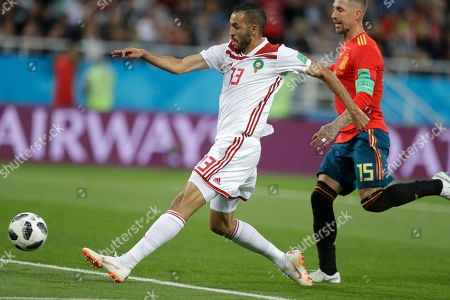 Morocco's Khalid Boutaib, left, misses an opportunity to score, next to Spain's Sergio Ramos, during the group B match between Spain and Morocco at the 2018 soccer World Cup at the Kaliningrad Stadium in Kaliningrad, Russia