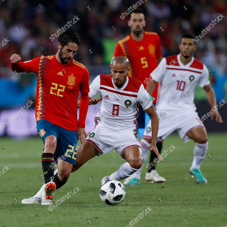 Spain's Isco, left, and Morocco's Karim El Ahmadi challenge for the ball during the group B match between Spain and Morocco at the 2018 soccer World Cup at the Kaliningrad Stadium in Kaliningrad, Russia