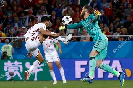 Morocco's Mbark Boussoufa, left, and Spain goalkeeper David De Gea challenge for the ball during the group B match between Spain and Morocco at the 2018 soccer World Cup at the Kaliningrad Stadium in Kaliningrad, Russia