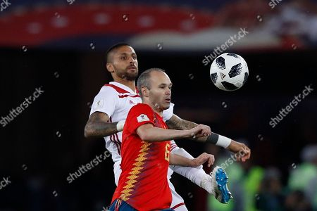 Morocco's Manuel Da Costa, background, and Spain's Andres Iniesta challenge for the ball during the group B match between Spain and Morocco at the 2018 soccer World Cup at the Kaliningrad Stadium in Kaliningrad, Russia