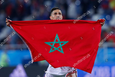 Morocco's Faycal Fajr lifts the national flag after the group B match between Spain and Morocco at the 2018 soccer World Cup at the Kaliningrad Stadium in Kaliningrad, Russia