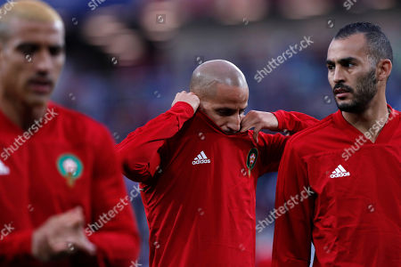 Morocco's Karim El Ahmadi, center, arrives with his team mates for warm up prior to the group B match between Spain and Morocco at the 2018 soccer World Cup at the Kaliningrad Stadium in Kaliningrad, Russia
