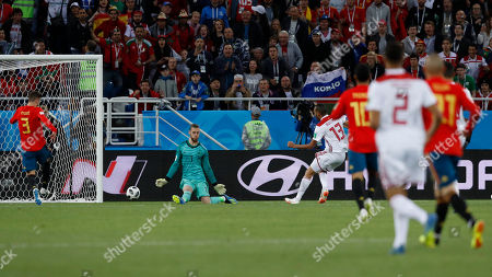 Morocco's Khalid Boutaib, right, scores his side's opening goal during the group B match between Spain and Morocco at the 2018 soccer World Cup at the Kaliningrad Stadium in Kaliningrad, Russia