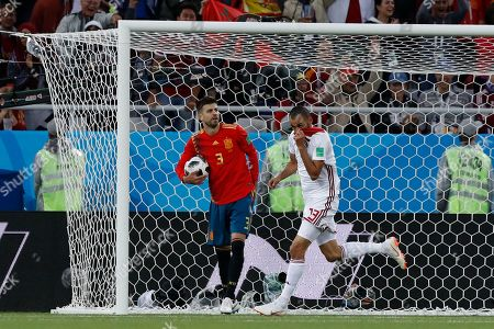 Morocco's Khalid Boutaib, right, celebrates after scoring his side's opening goal during the group B match between Spain and Morocco at the 2018 soccer World Cup at the Kaliningrad Stadium in Kaliningrad, Russia
