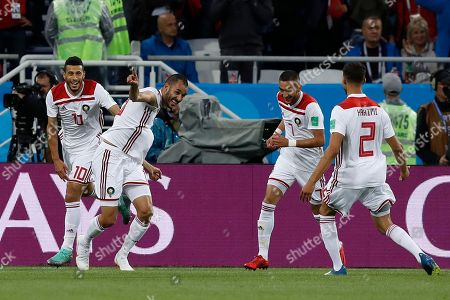 Morocco's Khalid Boutaib, left, celebrates after scoring his side's opening goal during the group B match between Spain and Morocco at the 2018 soccer World Cup at the Kaliningrad Stadium in Kaliningrad, Russia