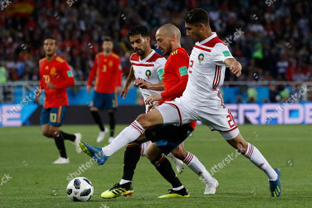 Morocco's Mbark Boussoufa, from left, Spain's David Silva and Morocco's Achraf Hakimi challenge for the ball during the group B match between Spain and Morocco at the 2018 soccer World Cup at the Kaliningrad Stadium in Kaliningrad, Russia