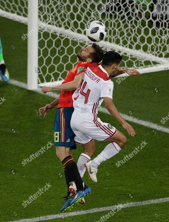 Jordi Alba, Mbark Boussoufa. Spain's Jordi Alba, left, and Morocco's Mbark Boussoufa, right, compete for the ball during the group B match between Spain and Morocco at the 2018 soccer World Cup in the Kaliningrad Stadium in Kaliningrad, Russia