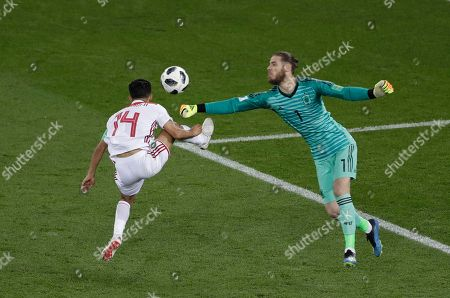 David De Gea, Mbark Boussoufa. Spain goalkeeper David De Gea, right, makes a save in front of Morocco's Mbark Boussoufa during the group B match between Spain and Morocco at the 2018 soccer World Cup in the Kaliningrad Stadium in Kaliningrad, Russia