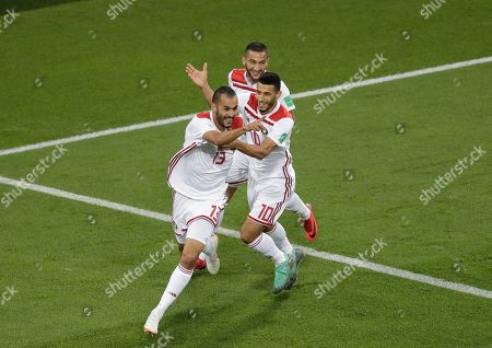 Morocco's Khalid Boutaib, left, celebrates after scoring his side's first goal during the group B match between Spain and Morocco at the 2018 soccer World Cup in the Kaliningrad Stadium in Kaliningrad, Russia