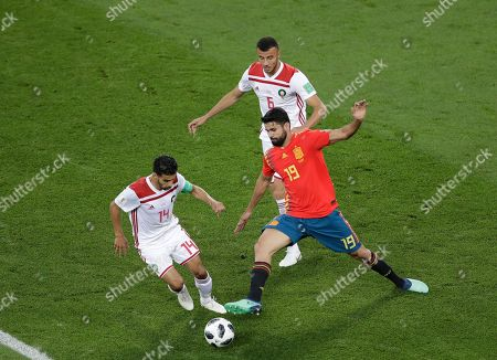 Diego Costa, Mbark Boussoufa. Spain's Diego Costa, right, and Morocco's Mbark Boussoufa, left, compete for the ball during the group B match between Spain and Morocco at the 2018 soccer World Cup in the Kaliningrad Stadium in Kaliningrad, Russia
