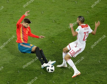 Gerard Pique, Khalid Boutaib. Spain's Gerard Pique, left, and Morocco's Khalid Boutaib, right, compete for the ball during the group B match between Spain and Morocco at the 2018 soccer World Cup in the Kaliningrad Stadium in Kaliningrad, Russia