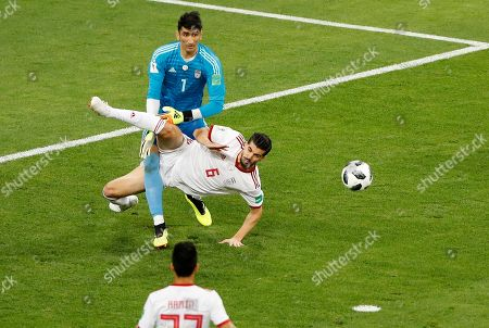 Iran goalkeeper Ali Beiranvand, left, and his teammate Saeid Ezatolahi try to catch the ball during the group B match between Iran and Portugal at the 2018 soccer World Cup at the Mordovia Arena in Saransk, Russia