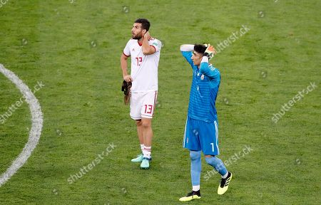 Stock Picture of Iran's Mohammad Reza Khanzadeh, left, and Iran goalkeeper Ali Beiranvand stands at the end of the group B match between Iran and Portugal at the 2018 soccer World Cup at the Mordovia Arena in Saransk, Russia