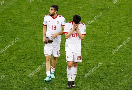 Stock Photo of Iran's Mohammad Reza Khanzadeh, left, and Iran's Sardar Azmoun leave the pitch at the end of the group B match between Iran and Portugal at the 2018 soccer World Cup at the Mordovia Arena in Saransk, Russia