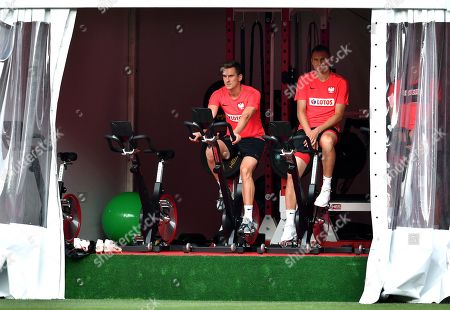 Polish national soccer team players Arkadiusz Milik (L) and Artur Jedrzejczyk (R) warms up during a training session in Sochi, Russia, 25 June 2018. Poland will face Japan in a group H match of the FIFA World Cup 2018 on 28 June 2018 in Volgograd.