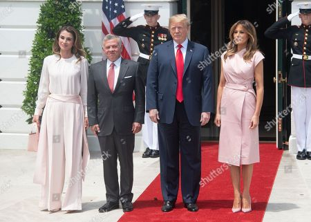 United States President Donald J. Trump, right center, and first lady Melania Trump, right, welcome King Abdullah II bin Al-Hussein, left center, and Queen Rania, left, of the Hashemite Kingdom of Jordan to the White House in Washington, DC.