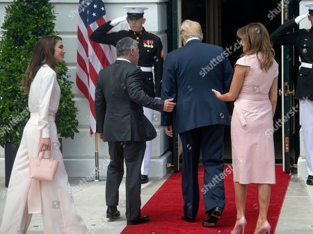United States President Donald J. Trump, right center, and first lady Melania Trump, right, and King Abdullah II bin Al-Hussein, left center, and Queen Rania, left, of the Hashemite Kingdom of Jordan walk into to the White House in Washington, DC.