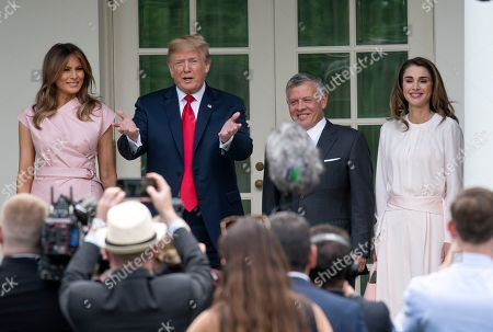 United States President Donald Trump Left center, first lady Melania Trump, left, and King Abdullah II bin Al-Hussein, right center, and Queen Rania, left, of the Hashemite Kingdom of Jordan pose for a group photo in front of the press pool at the White House in Washington, DC.